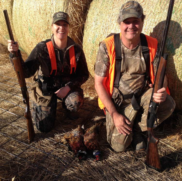 Dale and Becky displaying their phesants at Deadman Creek Outfitters