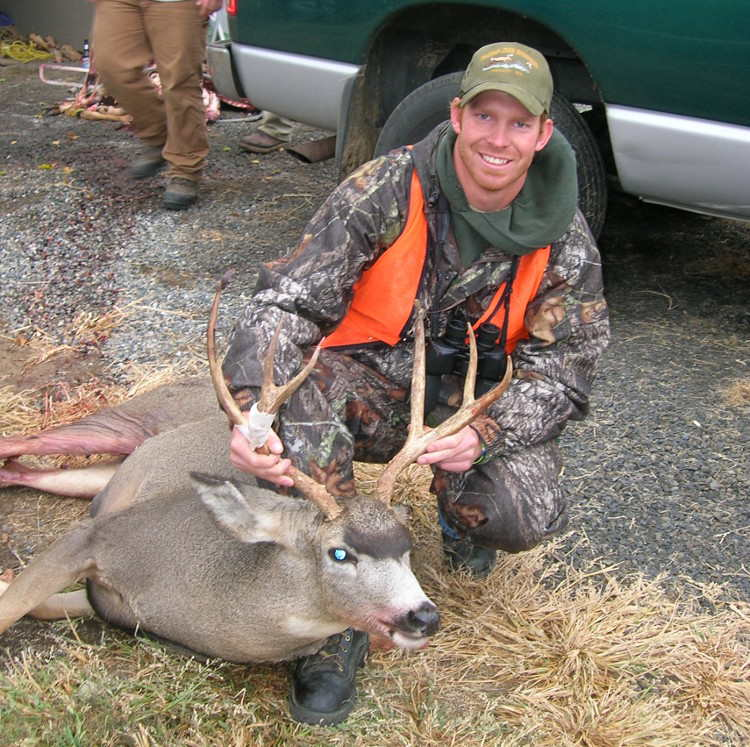 Man displaying his deer at Deadman Creek Outfitters